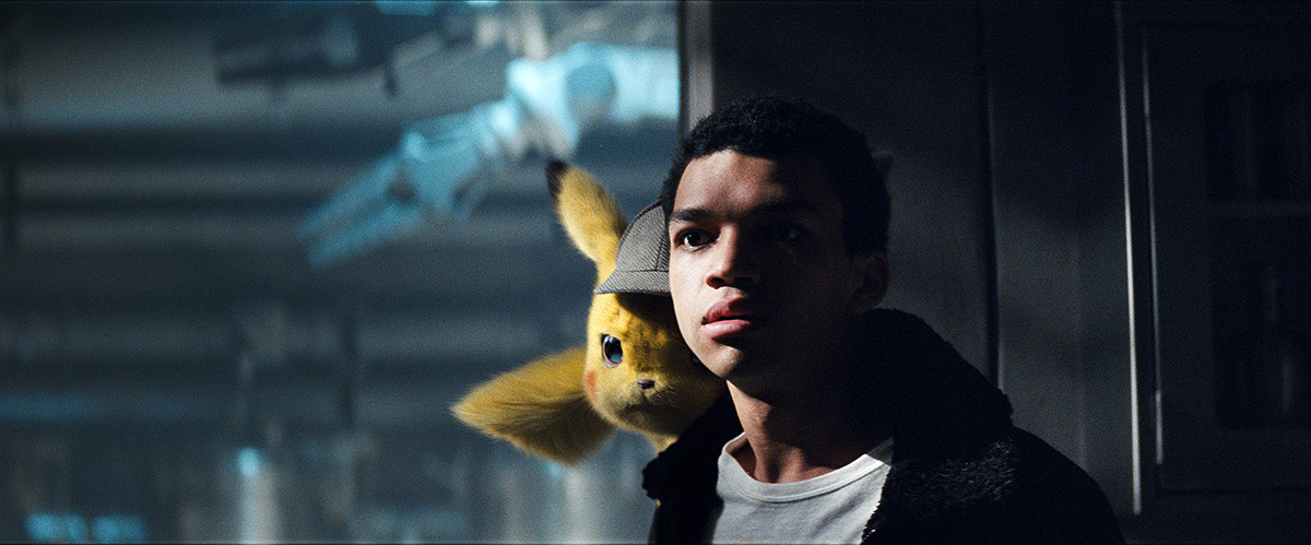 Justice Smith as Tim Goodman with Pikachu