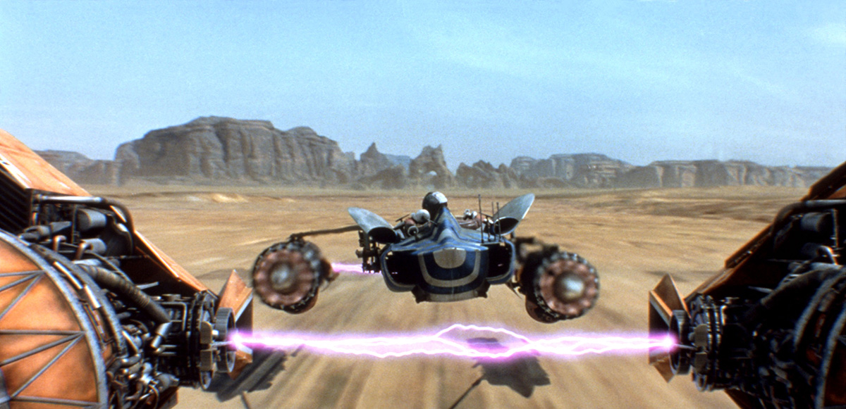 Anakin's podracer speeds along the desert landscape