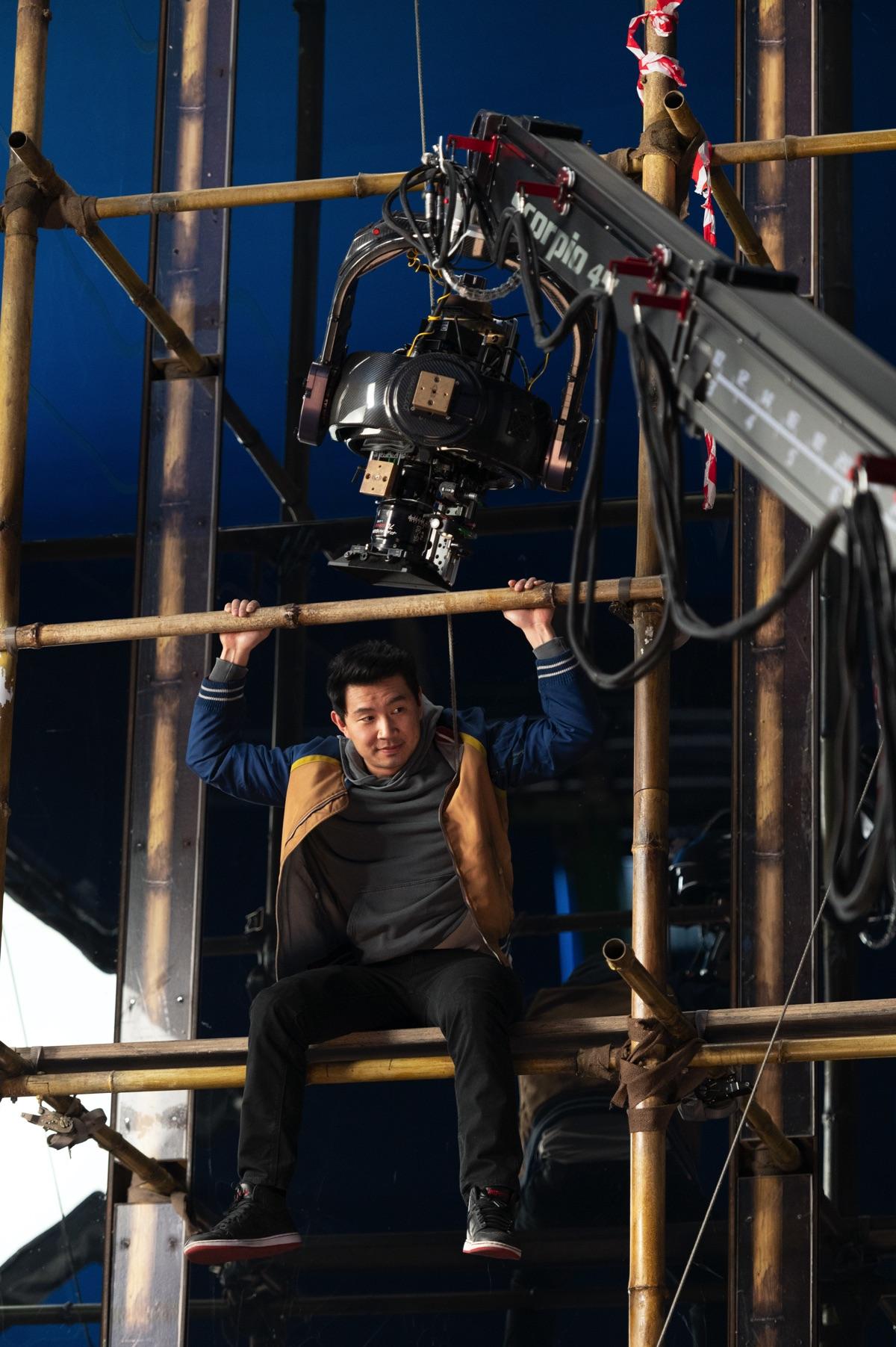 On The Set Pic: Simu Liu during the bamboo scaffolding fight